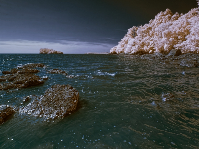Captured with B+W 092 infrared filter. A faux/false colors photo of Pasir Panjang beach of Borneo.