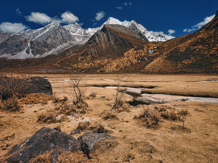 An faux color / false color image of Yading Nature Reserve of Daocheng. Captured with full spectrum converted Olympus E-PL5 camera mounted with Tiffen #47B dark blue filter. The image had been processed with Lightroom.